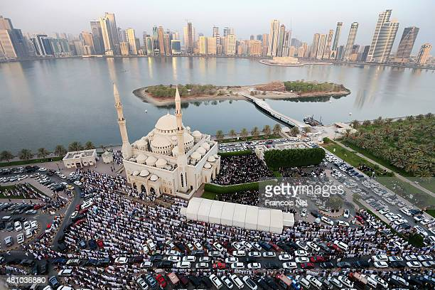 Muslims offer Eid alFitr prayers outside Al Noor Mosque on July 17 2015 in Sharjah United Arab Emirates The Muslim holiday Eid marks the end of 30...