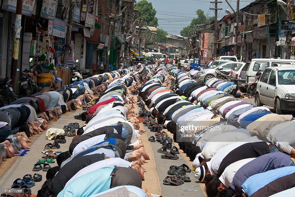 Muslims offer midday prayers on the first day of the holy month of Ramadan on July 11, 2013 in Srinagar, the summer capital of Indian administered Kashmir, India. Ramadan is the ninth month of the Islamic lunar calendar, during which Muslims believe the Quran was given to Prophet Muhammad. Muslims across the globe abstain from eating, smoking, and sex from dawn to dusk during the month. Besides spending more time praying, donating alms is mandatory. Every Muslim has to give 2.5 percent of their wealth and assets to the poor, and often give more.