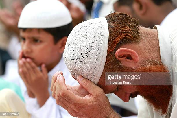 Muslims offer prayer on the occasion of Eid alFitr at Jama Masjid on July 17 2015 in New Delhi India The Islamic Eid alFitr holiday celebrates the...