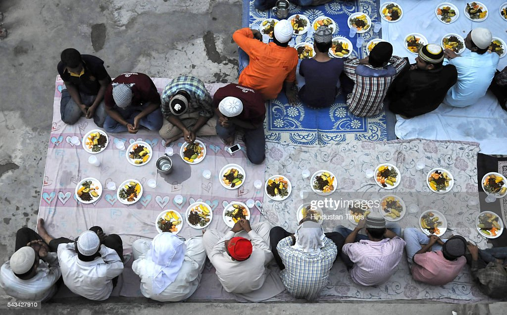 Muslims offer prayers before breaking their Roza fast with Iftar meal during the ongoing month of Ramzan on June 28, 2016 in Noida, India. In the ninth month of the Islamic calendar, Muslims worldwide observe Ramadan, a period of fasting and other rituals designed to bring self-purification through self restraint and other good deeds. The fasting begins at dawn and lasts until sunset, when observers break their fast with an evening meal called the Iftar.