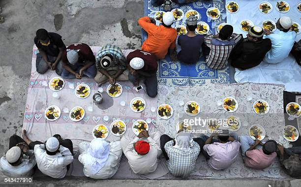 Muslims offer prayers before breaking their Roza fast with Iftar meal during the ongoing month of Ramzan on June 28 2016 in Noida India In the ninth...