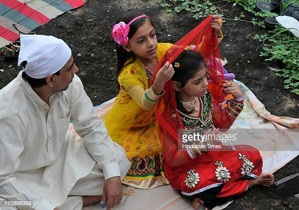 Muslims offer prayers on the occasion of EidalFitr at Feroz Shah Kotla Mosque on August 9 2013 in New Delhi India Muslims in India celebrated...
