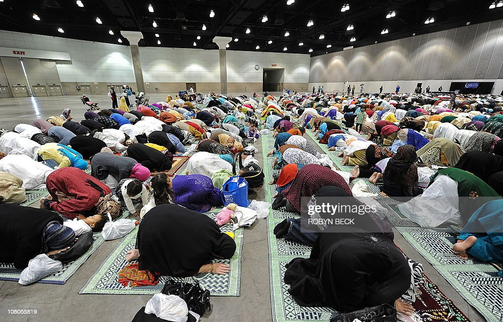 Muslims participate in the Eid alFitr prayer on September 10 2010 at the Los Angeles Convention Center in Los Angeles Muslims around the world...