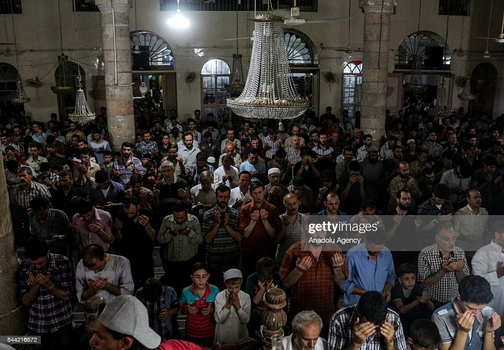 Muslims perform prayer on the Laylat al-Qadr (In Islamic belief the night when the first verses of the Quran were revealed) at Great mosque in Arbin town of East Ghouta region, Damascus, Syria on July 1, 2016.