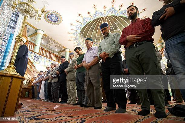Muslims perform the first 'Tarawih' prayer on this year's eve of Islamic holy month of Ramadan at the Suleymaniye Mosque in London England on June 17...