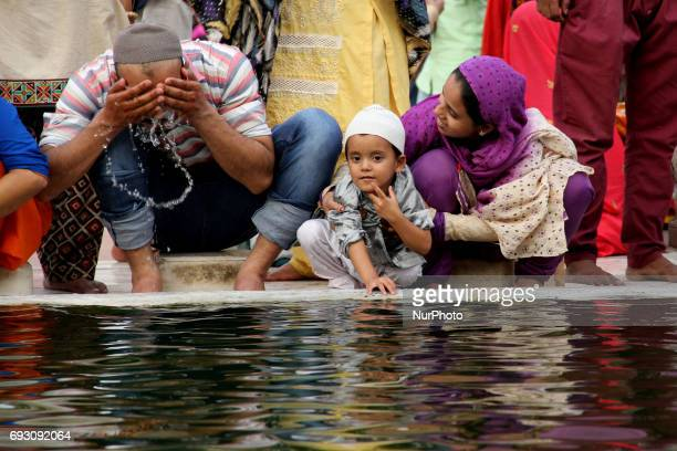 Muslims perform Wudu ritual purification during the holy month of Ramadan in Delhi on June 6 2017