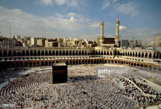 Muslims pray around the Kaaba Islam's most sacred sanctuary and pilgrimage shrine on Eid ulFitr day which commemorates the end of Ramadan within the...