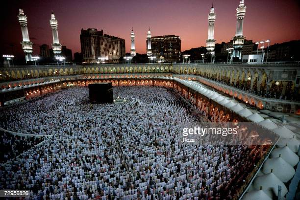 Muslims pray at dusk around the Kaaba Islam's most sacred sanctuary and pilgrimage shrine within the Masjid AlHaram mosque on Eid ulFitr day which...