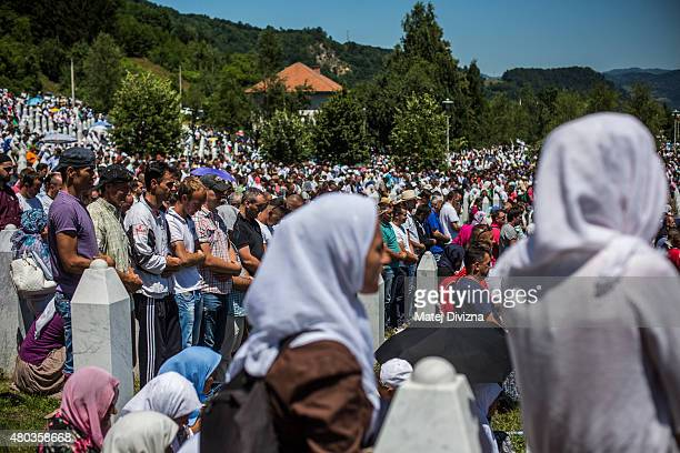 Muslims pray at the mass funeral for 136 newlyidentified victims of the 1995 Srebrenica massacre attended by tens of thousands of mourners during the...