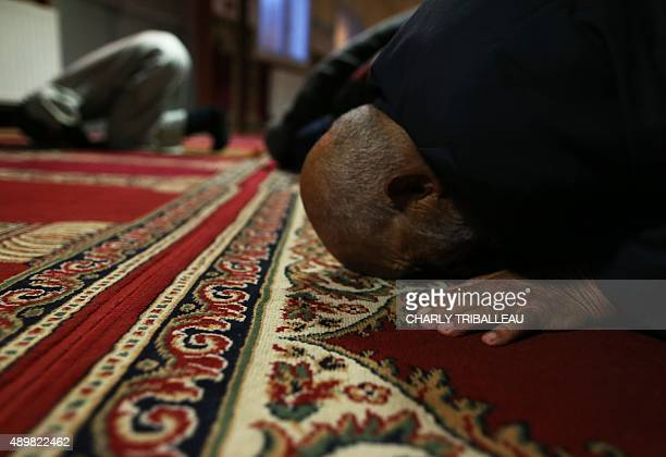 Muslims pray during the Muslim festivities of Eid alAdha at the mosque in CherbourgOcteville northwestern France on September 24 2015 AFP PHOTO /...