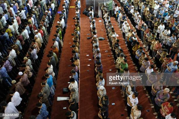 Muslims pray in Istiqlal Mosque on a Friday on November 25 2016 in Jakarta Indonesia Istiqlal Mosque is the largest mosque in Southeast Asia and was...