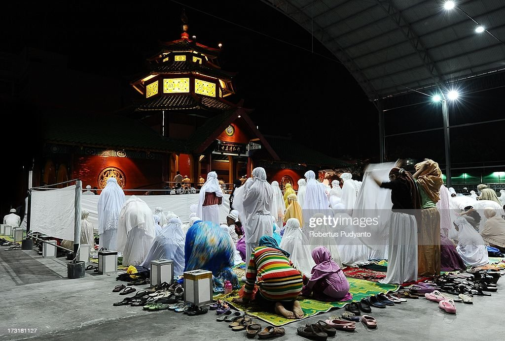 Muslims pray in the first Tarawih to mark the start of the month of Ramadan in Cheng Ho Mosque on July 9, 2013 in Surabaya, Indonesia. Muslims fasting in the month of Ramadan abstain from food, drink and sex from dawn until sunset, when they break the fast with the meal known as Iftar.