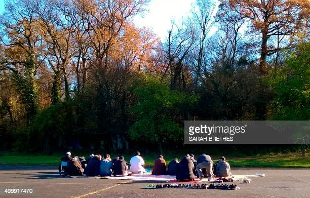 Muslims pray on December 4 2015 on a handball court in LagnysurMarne made available by the municipality after Police shut down a suspected radical...