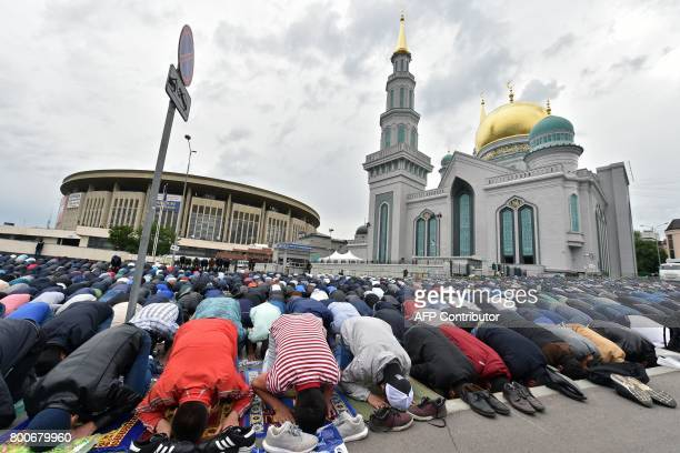 Muslims pray outside the central mosque in Moscow on June 25 during celebrations of Eid alFitr marking the end of the fasting month of Ramadan / AFP...