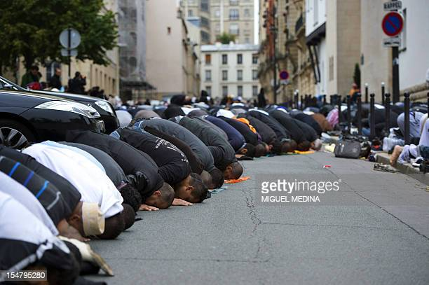 Muslims pray outside the Grande Mosque of Paris on the first day of Eid alAdha on October 26 2012 in Paris Eid alAdha or 'Feast of sacrifice' is...