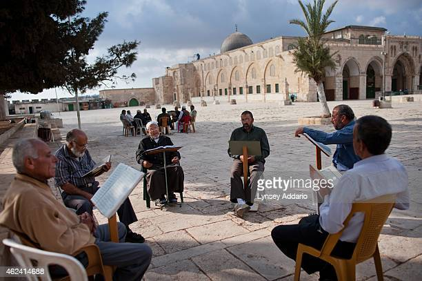 Muslims read the Quran and pray outside ofAlAqsa Mosque in Jerusalem Israel October 26 2011 Jerusalem is the holiest city in Judaism and the third...