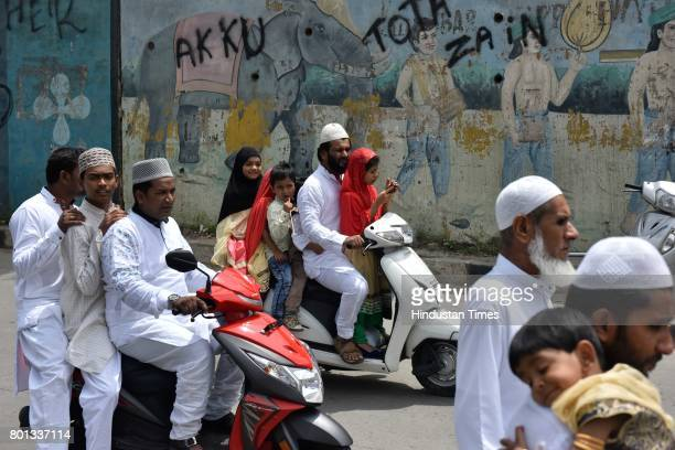Muslims returning after offering prayers on the occasion of EidUlFitr at Quddus Saheb Eidgah on June 26 2017 in Bengaluru India The celebrations...