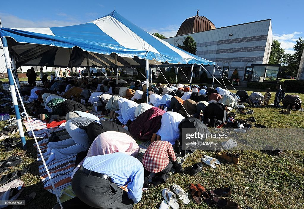 Muslims take part in a special Eid-al-Fitr prayer at a mosque in Silver Spring, Maryland, on September 10, 2010. Thousands of rock-pelting Afghans assaulted a NATO military outpost on September 10 as fury built across the Muslim world against a US pastor's threats to immolate the Koran on the anniversary of 9/11. In a turbulent start to the festival of Eid al-Fitr, when Muslims worldwide mark the end of the Ramadan fasting month, leaders of countries including Afghanistan and Indonesia issued dire warnings against the provocative act. AFP PHOTO/Jewel Samad