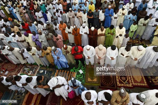 Muslims take part in the Eid alFitr prays at the Syrian Mosque at the Ikoyi district in Lagos on June 25 2017 Eid alFitr festival marks the end of...