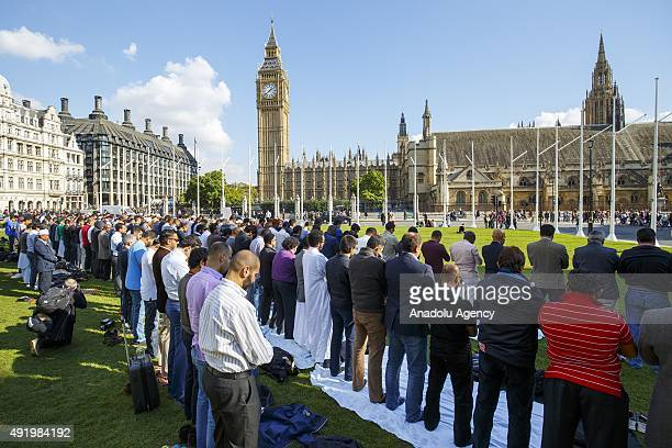 Muslims taking part at the first ever congregational Friday prayer in Parliament Square in London England on October 9 2015 The prayer was organised...