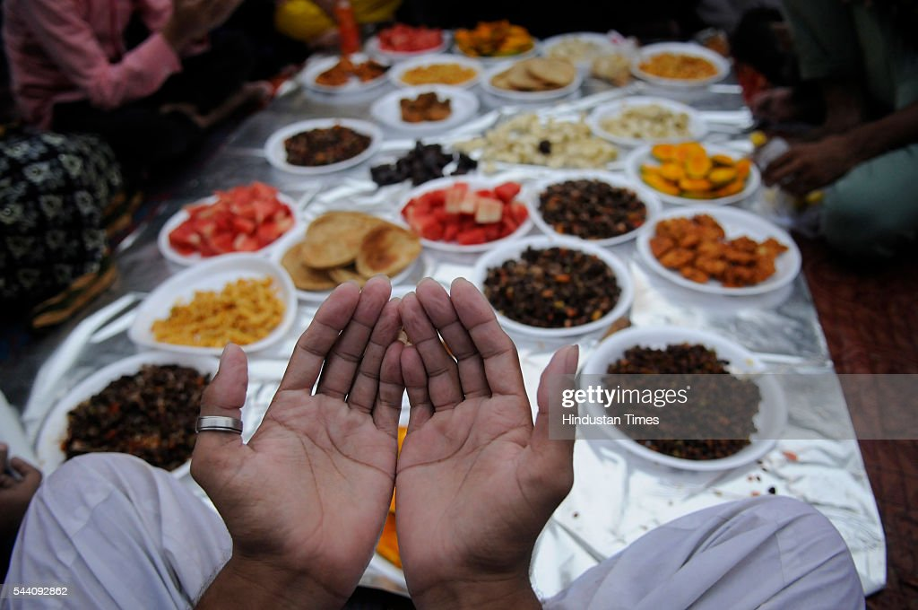 Muslims wait to break their fast on the last Friday of Ramadan, also called Jumu'atul-Wida, at Jama Masjid, on July 1, 2016 in New Delhi, India. Muslims throughout the world celebrate the holy fasting month of Ramadan, when they refrain from eating, drinking, and smoking from dawn to dusk.