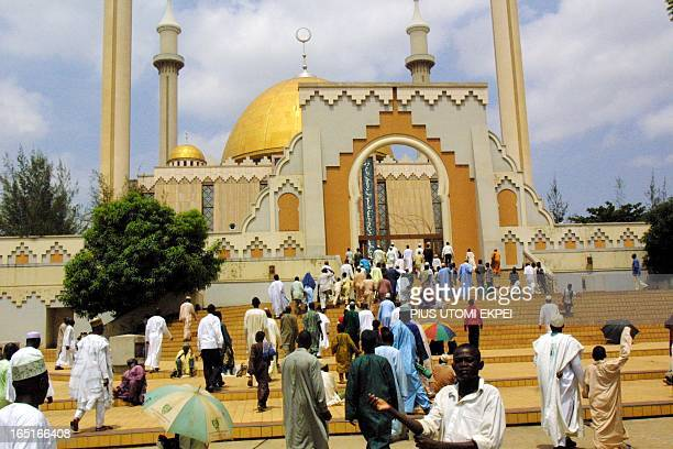 Muslims walk into Abuja National Mosque for their juma't prayers Friday 25 April 2003 Muslims all over the country prayed for the peaceful conduct of...