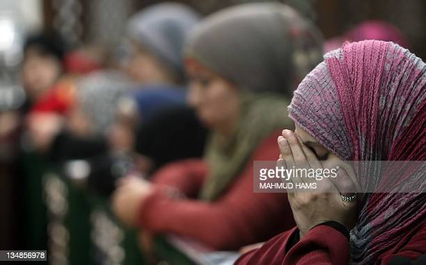 Muslims women pray in the alHussein mosque where according to belief the head of Imam Hussein the grandson of prophet Mohammed is buried in the old...