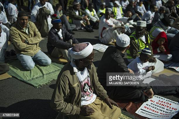 Muslims worshippers perform the Ffriday prayer ahead of protest against the Egyptian Government and ask for the release of South African humanitarian...