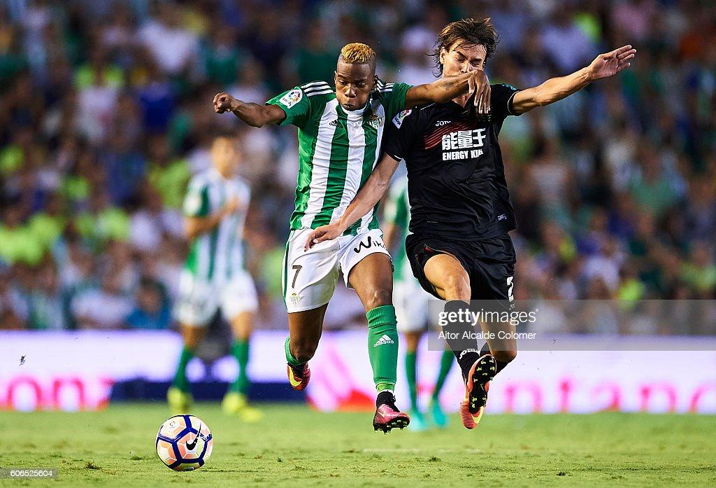 Musonda JR of Real Betis Balompie (L) being followed by Rene Krhin of Granada CF (R) during the match between Real Betis Balompie vs Granada CF as part of La Liga at Benito Villamarin stadium on September 16, 2016 in Seville, Spain.