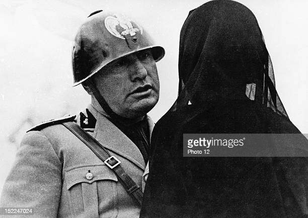 Mussolini discussing with the widow of an Italian who had volunteered for war service and who died on the Spanish front 1937