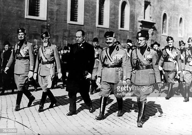 Mussolini marches on Rome with four of his generals and a number of fascist troops