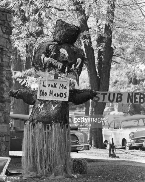 Must Be Trying to Scare Nebraska This ogre in hula skirt and 'no hands' must have been designed to put a scare into the University of Nebraska team...