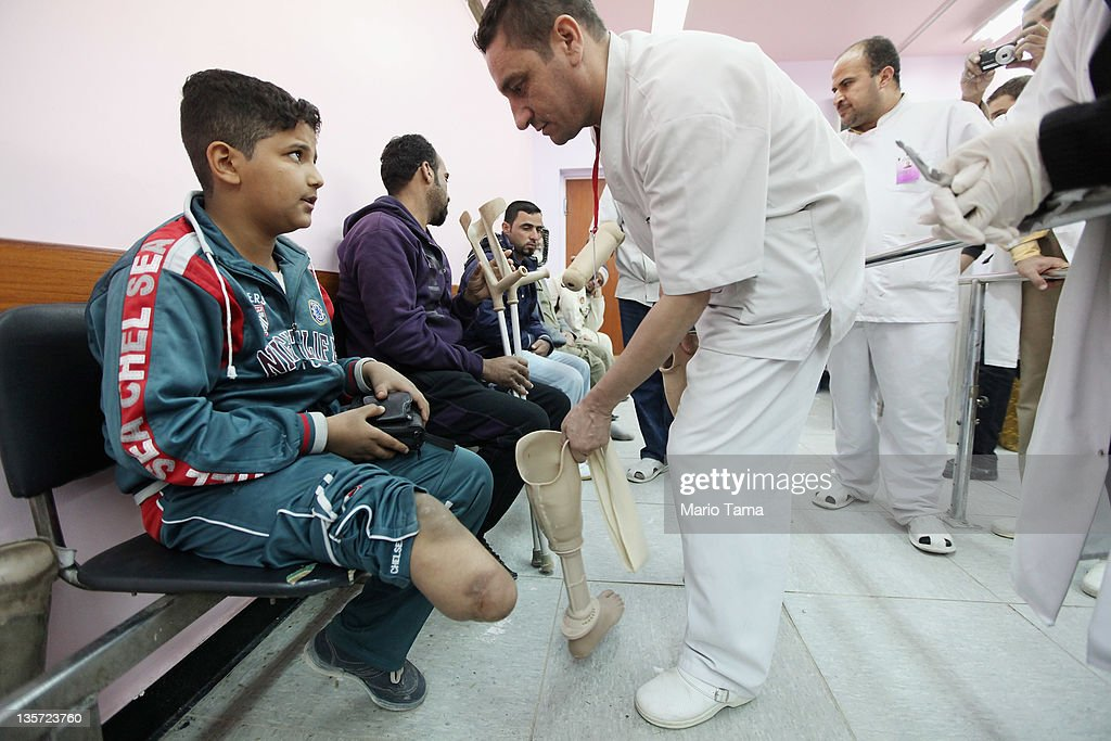 Mustafa Ahmed, 11, who was wounded by an American bomb during the 2003 U.S. invasion, is fitted for a new prosthetic for his lower leg at the Hospital of Physiotherapy on December 13, 2011 in Baghdad, Iraq. Iraq's health care system remains in shambles following decades of war and economic sanctions. Following the 2003 U.S. invasion, thousands of physicians fled the country while others were killed. Some physicians have since returned but there is still a critical shortage of doctors. Iraq is transitioning nearly nine years after the 2003 U.S. invasion and subsequent occupation. American forces are now in the midst of the final stage of withdrawal from the war-torn country. At least 4,485 U.S. military personnel have died in service in Iraq. According to the Iraq Body Count, more than 100,000 Iraqi civilians have died from war-related violence.
