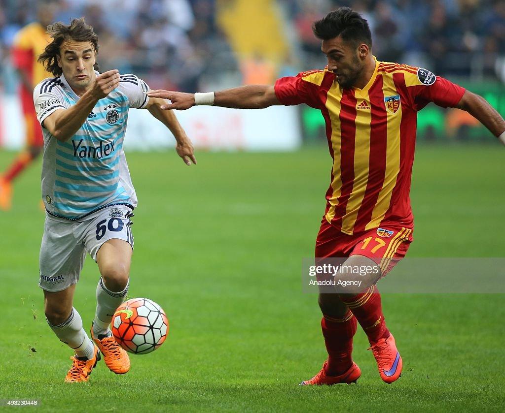 Mustafa Akbas of Kayserispor in action against Lazar Markovic of Fenerbahce during the Turkish Spor Toto Super League football match between...