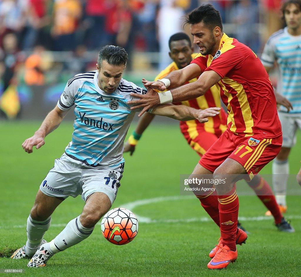 Mustafa Akbas of Kayserispor in action against Robin Van Persie of Fenerbahce during the Turkish Spor Toto Super League football match between...