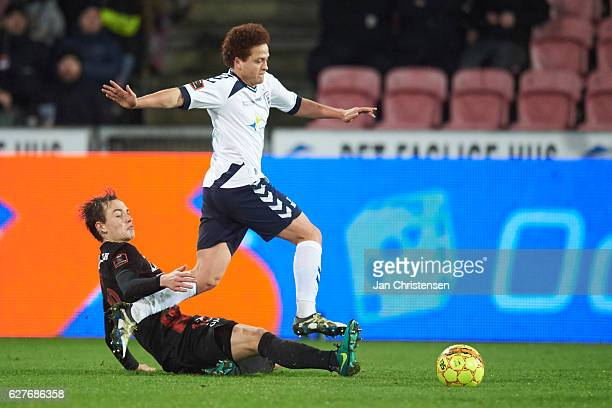 Mustafa Amini of AGF Arhus compete for the ball during the Danish Alka Superliga match between FC Midtjylland and AGF Arhus at MCH Arena on December...