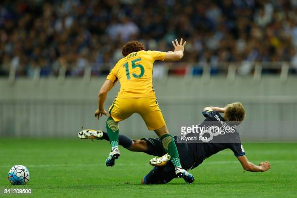 Mustafa Amini of Australia and Genki Haraguchi of Japan compete for the ball during the FIFA World Cup Qualifier match between Japan and Australia at...