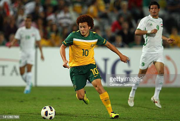 Mustafa Amini of Australia dribbles the ball during the third round 2012 Olympic Games Asian Qualifier match between Australia and Iraq at Bluetongue...