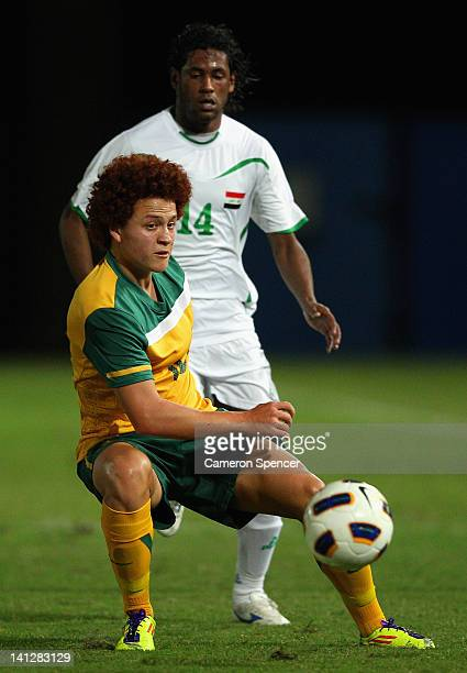 Mustafa Amini of Australia kicks during the third round 2012 Olympic Games Asian Qualifier match between Australia and Iraq at Bluetongue Stadium on...
