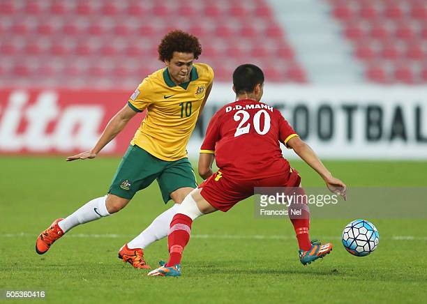 Mustafa Amini of Australia takes on Do Duy Manh of Vietnam during the AFC U23 Championship Group D match between Vietnam and Australia at Grand Hamad...