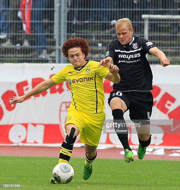 Mustafa Amini of Borussia Dortmund II and Anton Mueller of Hallescher FC battle for the ball during the 3 Liga match between Borussia Dortmund II and...