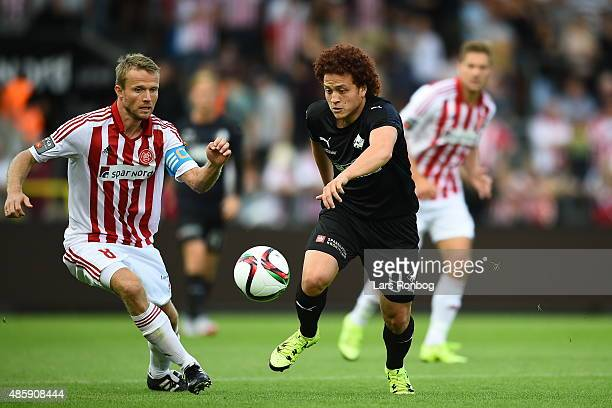 Mustafa Amini of Randers FC and Rasmus Wurtz of AaB Aalborg compete for the ball during the Danish Alka Superliga match between AaB Aalborg and...