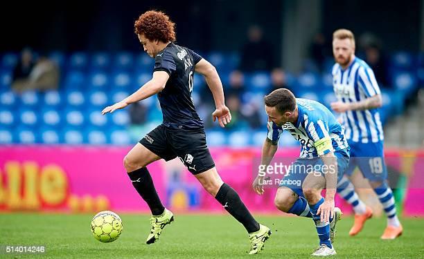 Mustafa Amini of Randers FC in action against Magnus Lekven of Esbjerg fB during the Danish Alka Superliga match between Esbjerg fB and Randers FC at...