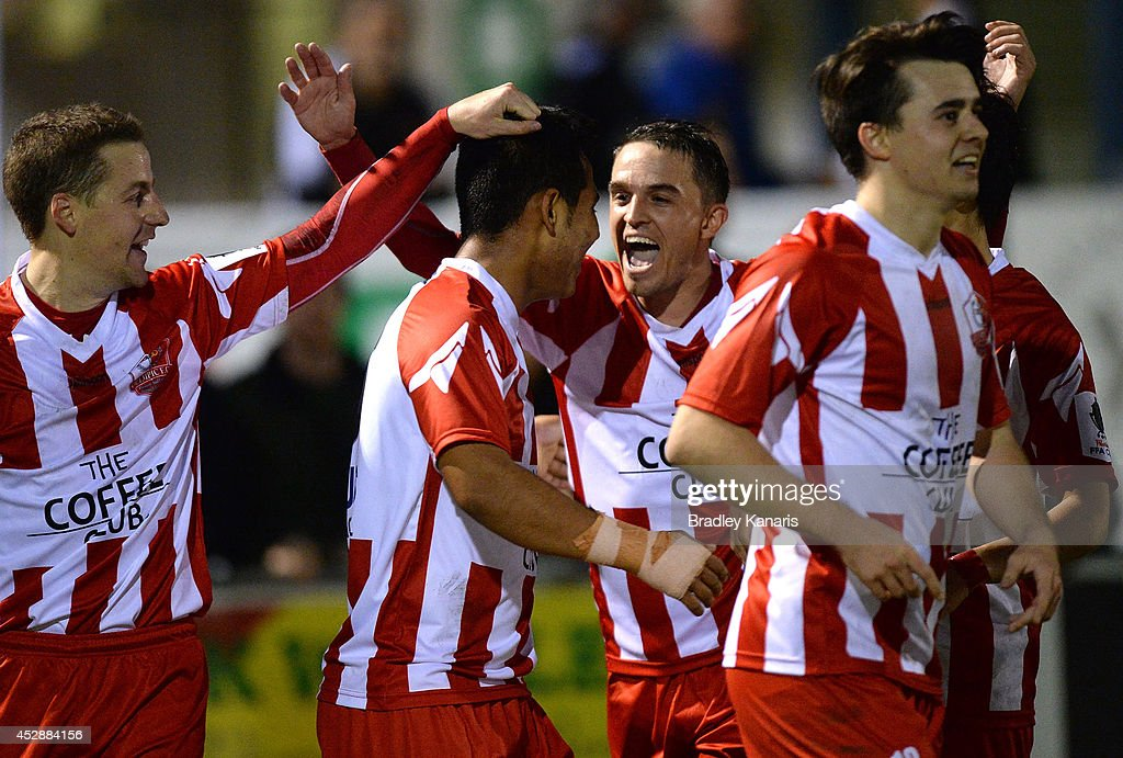 Mustafa Jafari of Olympic celebrates with team mates after scoring a goal during the FFA Cup match between Olympic FC and Melbourne Knights at Goodwin Park on July 29, 2014 in Brisbane, Australia.