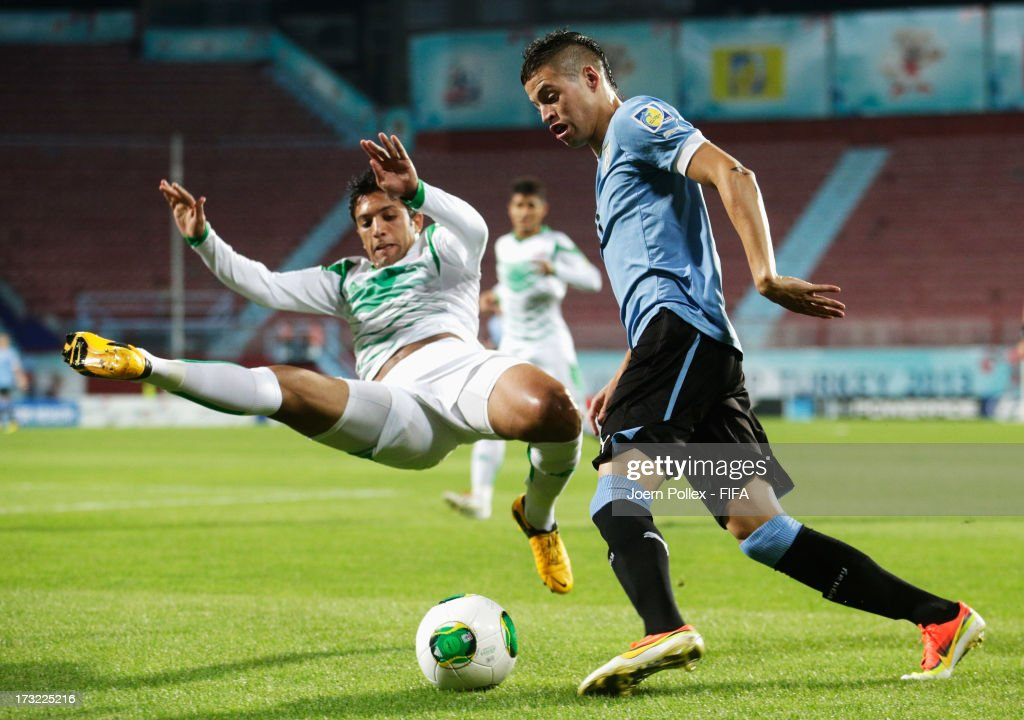 Mustafa Nadhim (L) of Iraq and Nicolas Lopez of Uruguay compete for the ball during the FIFA U-20 World Cup Semi Final match between Iraq and Uruguay at Huseyin Avni Aker Stadium on July 10, 2013 in Trabzon, Turkey.