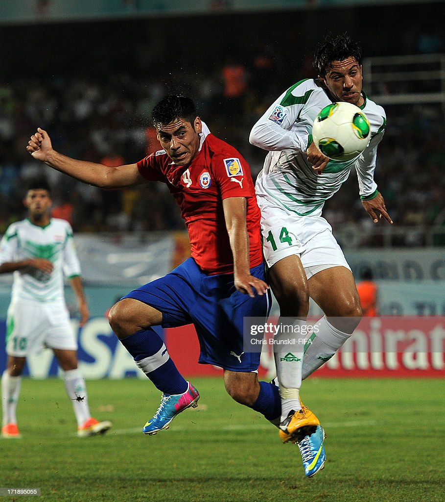 Mustafa Nadhim (R) of Iraq jumps with Felipe Mora of Chile during the FIFA U20 World Cup Group E match between Iraq and Chile at Akdeniz University Stadium on June 29, 2013 in Antalya, Turkey.