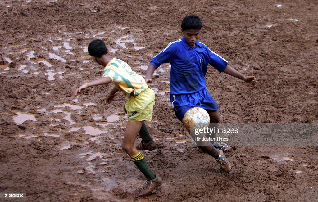 Mustafa Sakarwala (in green uniform) of Saifi High School and Deghani Nujiaba of St. Joseph High School (Umarkhadi), fighting for the possession of the ball in the MSSA Boys U-16, Div.-IV-P match at Azad Maidan today on July 19, 2005 in Mumbai, India.