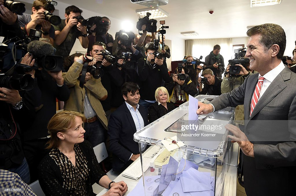 Mustafa Sarigul, candidate of the Republican Peoples Party (CHP) running for the Istanbul city hall, casts his ballots in the Sisli district of Istanbul, during the first round of the local elections on March 30, 2014 in Istanbul, Turkey.The nationwide municipal elections held today are seen as a referendum on Prime minister Recep Tayyip Erdogan's tenure as he struggles to survive recent scandals. The candidate who wins the city hall vote could be a leading candidate into the presidential vote in six months and parliamentary polls next year.