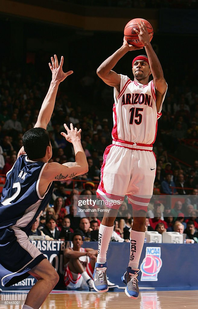 Mustafa Shakur of the Arizona Wildcats puts up a shot over David Pak of the Utah State Aggies during the 2005 NCAA division 1 men's basketball...