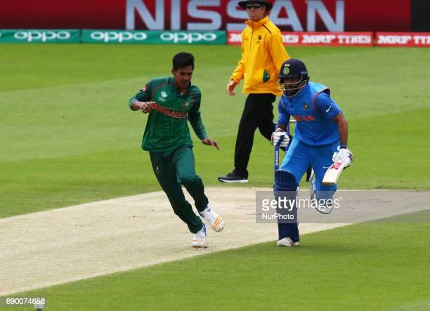 LR Mustafizur Rahman of Bangladesh and Shikhar Dhawan of India during the ICC Champions Trophy Warmup match between India and Bangladesh at The Oval...